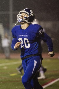 Southington's Jasen Rose smiles after he scores a touchdown in the Class LL quarterfinals against Conard. (Erin Covey/RA)