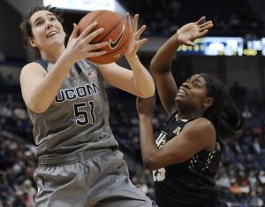 Connecticutís Natalie Butler looks for a shot against UCFís Tolulope Omokore, right, during the second half of an NCAA college basketball game Wednesday, Jan. 20, 2016, in Hartford, Conn. UConn won 106-51. (AP Photo/Jessica Hill)