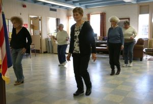 Rachel Stearns Republican-American Lucy Wysokinski, of Naugatuck, dances with a group of country line dancers at the Naugatuck Senior Center Wednesday morning. The Naugatuck and Watertown senior centers will soon be offering a joint dance program.