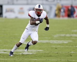 Connecticut wide receiver Noel Thomas runs against Central Florida after a reception during the second half of an NCAA college football game, Saturday, Oct. 10, 2015, in Orlando, Fla. Connecticut won 40-13. (AP Photo/John Raoux)