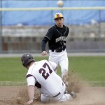 Woodland's Matt Butterworth throws to first as Torrington's Kobe Covington slides into second during their NVL baseball matchup at Fuessenich Park on Saturday.     Christopher Massa Republican-American