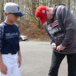 Former two-time baseball all-star with the Cincinnati Reds, Rob Dibble, signs an autograph for Colin Markelon following the opening ceremony of Middlebury Baseball on Saturday at Quassy Field. Dibble, who will run a two-week baseball camp this summer at Quassy Field, was the special guest.  (Palladino/RA)