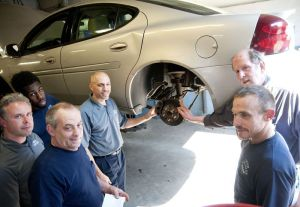 United Auto Sales & Service on Congress Avenue in Waterbury was one of 15 shops that use ACDelco parts chosen to repair cars for needy customers for free Wednesday in celebration of ACDelco's 100th anniversary. Pictured are from far left M.J. Johnson, Bob Laporta Jr., Ray Civitello, Louis Codianna, Todd Laporta and Charles Longo. Not pictured are Joe Longo Jr. and Tom Moscariello. Alec Johnson/ Republican-American