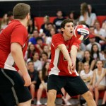 Cheshire's James Marinaccio returns the ball during their SCC volleyball matchup against Daniel Hand in Cheshire on Friday.  Also in the play is teammate,  Zach Feldman. Cheshire would go onto win, 3-2.    Christopher Massa Republican-American