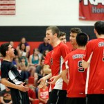 Cheshire's Mitchell Manware, left, and Matt Pinciaro celebrate with their team during the SCC volleyball matchup against Daniel Hand in Cheshire on Friday.  Cheshire would go onto win, 3-2.    Christopher Massa Republican-American