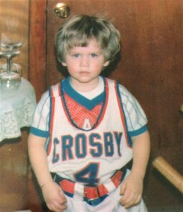 Ryan Olsen, then age 4, is a nephew of Crosby boys basketball coach Nick Augelli. Olsen, recently hired as the new coach at Holy Cross, used to be a ball boy for the Bulldogs. (Contributed)