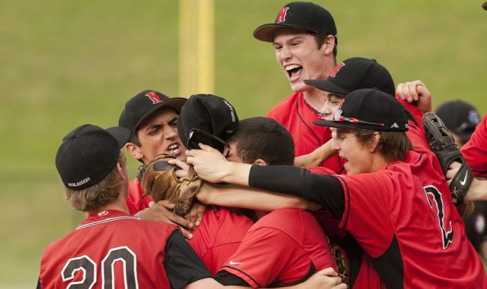 Northwestern players celebrate their 6-1 win over Sheehan in the Class M semi-finals Tuesday at Sage Park in Berlin. Jim Shannon Republican-American