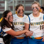 Seymour's Amanda Harkins, left, Cassie Rossetti, center and  Raeanne Geffert celebrate their 1-0 win over Rocky Hill to capture the Class M state championship Friday at DeLuca Field in Stratford.   Jim Shannon Republican-American