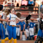 Raeanne Geffert is greeted by teammates after pitching out of a jam during their Class M state finals game against Rocky Hill Friday at DeLuca Field in Stratford.   Jim Shannon Republican-American