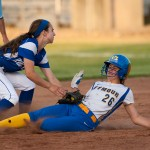 Seymour's (26) is tagged out  by Rocky Hill's Sophie Kurdziel (1) while trying to steal second during their Class M state finals game Friday at DeLuca Field in Stratford.   Jim Shannon Republican-American