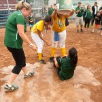 Holy Cross head coach Megan Dwyer gets dosed with water following their 2-0 win over Notre Dame-Fairfield to capture the Class S state championship Notre Dame-Fairfield Saturday at DeLuca Field in Stratford.   Jim Shannon Republican-American