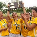 Holy Cross captains, from left,  Becca Anderson, Lindsay Barton, Lauren Dwyer and Mackenzie Dolishny hoist the championship trophy following their 2-0 win over Notre Dame-Fairfield to capture the Class S state championship Notre Dame-Fairfield Saturday at DeLuca Field in Stratford.   Jim Shannon Republican-American