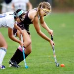 Jess Timm of Nonnewaug High and #14 Morgan Sanson of Thomaston High battle for the ball during field hockey action in Woodbury Tuesday. Steven Valenti Republican-American