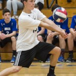 Lewis Mills' Austin Gilbert digs the ball while playing Masuk in the quarterfinals of the Class M tournament in Burlington Friday night. Erin Covey Republican-American