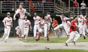 Wolcott High baseball team celebrates as #24 Raymond Bartoli hit a 2 run homer in the bottom of the 7th to win the CIAC Class M championship against Northwestern Regional High at Palmer Field in Middletown Friday. Steven Valenti Republican-American