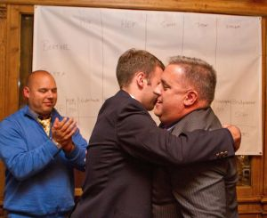 From left, Republican Town Committee Vice Chairman Erik Markiewicz cheers as campaign manager Adam Kueglar gives winning candidate Eric C. Berthel a congratulatory hug after Berthel won the state's 68th House District seat in 2014 at Roma Ristorante in Watertown. Laraine Weschler Republican-American