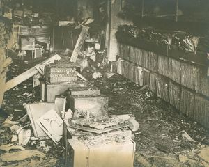 A record store is charred after a firebomb was thrown into it during a violent uprising in North Square in 1969. Republican-American archive