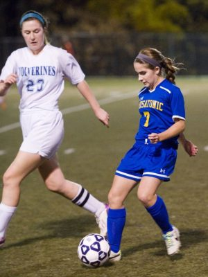 WATERBURY, CT- 11 November 2014-111114EC04-- Housatonic's Maddie Horosky brings the ball down the field as Oxford's Julia Low-Chappell runs beside her. Housatonic won the Class S semifinal game, 3-2, at Municipal Stadium. Erin Covey Republican-American