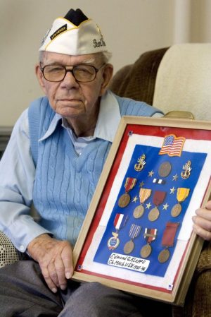 Ed Klepps sits with his medals at the Lutheran Home in Southbury in 2011. Klepps is a Pearl Harbor veteran and survivor of the Japanese attack. Klepps, 97 when this photo was taken, could still recall the moment the attack started on U.S. soil.   Republican-American archive
