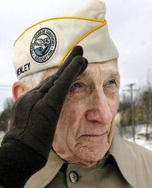Pearl Harbor survivor Art Schreier of Watertown, salutes during a Pearl Harbor ceremony in 2006. Republican-American archive