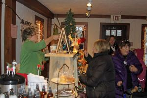 Shoppers crowd into the Old Factory by the River Saturday afternoon during Christmas in Riverton.