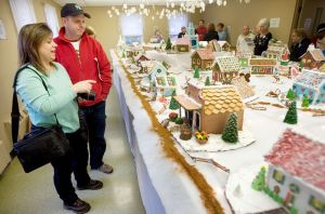 Sue and Ken Kliczewski of Newtown check out the Gingerbread Village during the annual Gingerbread Village and Christmas Bazaar at St. George's Episcopal Church in Middlebury Saturday. Steven Valenti Republican-American