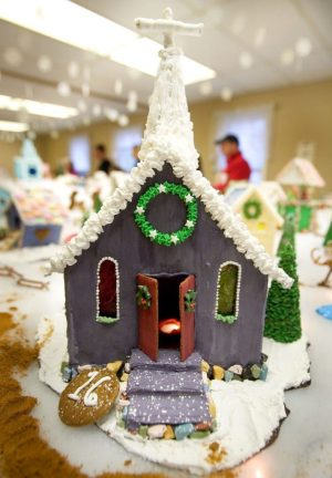 Kristine Boisits of Middlebury built this Church of New Life gingerbread church for the annual Gingerbread Village and Christmas Bazaar at St. George's Episcopal Church in Middlebury Saturday. Steven Valenti Republican-American