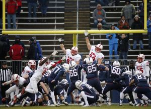 Connecticut place kicker Bobby Puyol (17) makes a field goal attempt during the first quarter of an NCAA college football game against Southern Methodist in East Hartford, Conn., Saturday, Dec. 6, 2014. (AP Photo/Michael Dwyer)
