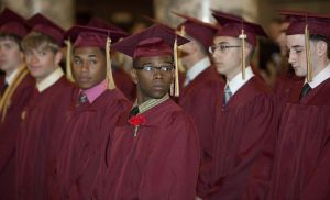 Sacred Heart High School graduates appear at a 2013 ceremony. The Archdiocese of Hartford, which includes Sacred Heart, is among 13 districts in the state recognized for significant increases in students taking advanced placement exams between 2012 and 2014.  republican-american archives