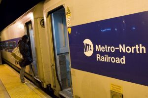 A passenger boards the last Metro-North train of the night Friday at the Waterbury Train Station. Metro-North recently added two late-night weekend trains on the Waterbury branch. Erin Covey/RA