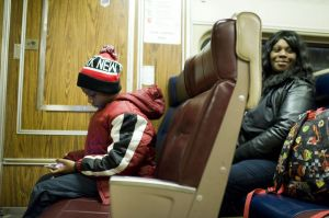 Tay Moten of Stamford and his mother, Amber Jenkins, board the last Metro-North train of the night Friday at the Waterbury Train Station. They said they're thankful for the new late-night service on the Waterbury branch. Erin Covey/RA