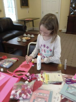 Lilly MacMillan designs a valentine card during Saturday's Valentine Tea cosponsored by the Hotchkiss Library and the Sharon Historical Society. Ruth Epstein Republican-American