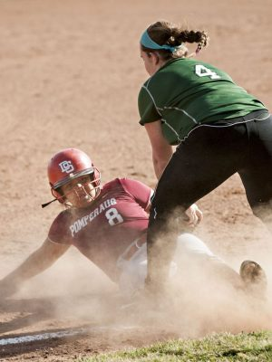 SOUTHBURY, CT-16 April 2015-041615EC03- Pomperaug's Kaela Harris slides safely into third and New Milford's Avery Kelly. She scored a run in the next play Thursday in Southbury. Erin Covey Republican-American
