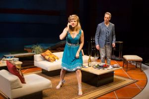 """Arden Myrin and Patrick Breen star in """"Meteor Shower,"""" a new play by Steve Martin now at Long Wharf Theatre in New Haven. (Photo by T. Charles Erickson)"""