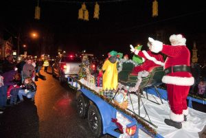Santa and Mrs. Claus wave to the hundreds who lined Main Street during the Light Up Thomaston parade last year. The event returns on Saturday night. Republican-American Archive