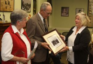 Victoria Sansing, right, of the Greater Litchfield Preservation Trust, presents the organization's Award of Distinction to Judy and Don Iffland of the East Litchfield Village Improvement Society.