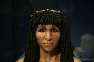FILE - In this Sept. 10, 2015 file photo, the reconstructed face of an Egyptian mummy known as the Gilded Lady is on display at the Natural History Museum, in Los Angeles. It is part of a traveling exhibition that used CT scanning to