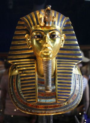 In this Feb. 15, 2010 photo, the golden mask of Egypt's famous King Tutankhamun is displayed at the Egyptian museum in Cairo, Egypt. Egypt's famed King Tutankhamun suffered from a cleft palate and club foot, likely forcing him to walk with a cane, and died from complications from a broken leg exacerbated by malaria, according to the most extensive study ever of his mummy. (AP Photo/Amr Nabil)