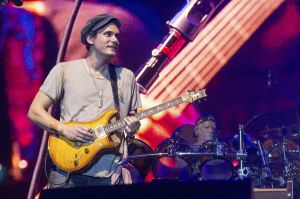 FILE - In this June 12, 2016 file photo, John Mayer of Dead & Company performs at Bonnaroo Music and Arts Festival in Manchester, Tenn. Mayer won't be performing at a tribute concert honoring the late rock icon Prince on Thursday. Concert promoter Randy Levy told the Minneapolis Star Tribune late Tuesday, Oct. 11, that Mayer had a