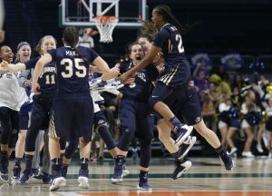 Quinnipiac's Carly Fabbri (5) celebrates with Morgan Manz (35) and Aryn McClure, right, after a second round game in the NCAA women's college basketball tournament against Miami, Monday, March 20, 2017, in Coral Gables, Fla. Quinnipiac won 85-78. (AP Photo/Lynne Sladky)