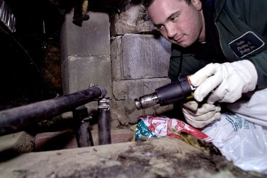 In this archive photo from 2004, Carlo Fasano, a Scoville Plumbing and Heating Inc. apprentice mechanic out of Torrington, warms a frozen well pipe under home in New Hartford. Scoville Plumbing recently closed because of declining business. Republican-American archives