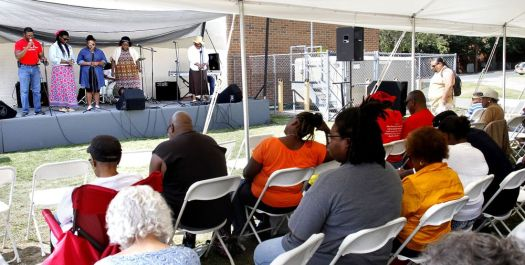 Gospel Expo worshippers listen as Refuge Church of Christ Assistant Pastor Jason Ward leads an opening prayer Saturday afternoon at the North End Recreation Center in Waterbury.  Jonathan Wilcox Republican-American