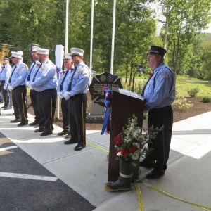 John B. Allyn, president of the Falls Village Volunteer Fire Department, addresses the crowd at Sunday's dedication ceremony for the new Emergency Services Center. Ruth Epstein Republican-American