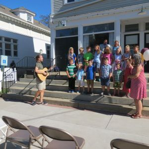 cutline attribution name:photos by Ruth Epstein Republican-American Students from Lee H. Kellogg School sing about Falls Village to the tune of 'Country Roads' during Saturday's celebration for First Selectman Patricia A. Mechare.
