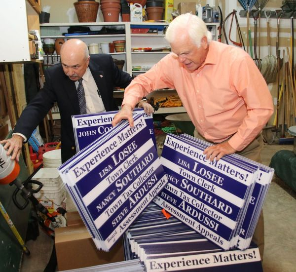 Litchfield Republican Town Committee Chairman William Burgess, right, and Michael Thomas, a Republican candidate for the Planning and Zoning Commission, sort through GOP campaign signs during the town committee's candidate meet and greet at Burgess' home on Thursday. John McKenna Republican-American
