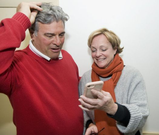 Torrington Mayor Elinor C. Carbone shows her husband, Gerry, a congratulatory text from her son, Nick Carbone, who lives in New York City, after winning a second term Tuesday at the Sons of Italy Hall in Torrington. Jim Shannon Republican-American