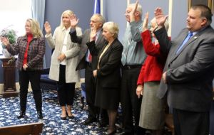The newly elected Winsted Board of Selectmen votes for mayor and second selectman after being sworn in at Town Hall on Wednesday. A. Candy Perez was selected as mayor again and Steven Sedlack was chosen as second selectman. Steven Valenti Republican-American
