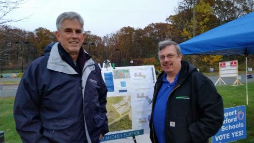 School building committee members Dean Golembeski, left, and Rich Krueger, remind voters of the referendum question for the $44.9 million building school project at the polls outside Quaker Farms School on election day Tuesday. Bill Bittar Republican-American