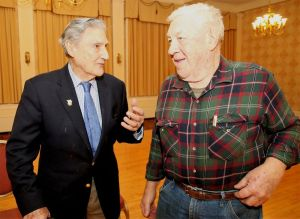 Ted Marolda, left, of Winsted, at 94 one of the oldest living Marine veterans who served during World War II, talks with Marine veteran Joe Lesieur of Collinsville during a celebration of the 242nd anniversary of founding of the Marines on Friday at the Torrington Elks Club. Marolda was with the Marine division that landed on Guadalcanal in the South Pacific on Aug. 7, 1942, and engaged the Japanese in combat in the first offensive of the war. John McKenna Republican-American