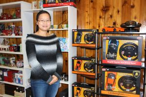 Cindy Zheng, who co-owns Toy Hut with her mother-in-law, is super excited about the Lamborghini series of electric race cars that she now carries for racing enthusiasts, young and old. The new store is at 50 Bank Street in New Milford's historic district. Alicia Sakal/ Republican-American